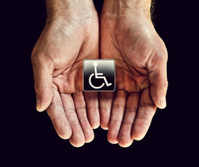 disabled badge in hands