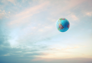 world golf ball in sky