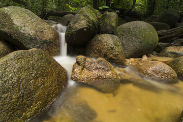 Small waterfall in tropical rainforest