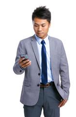 Asian businessman look at mobile