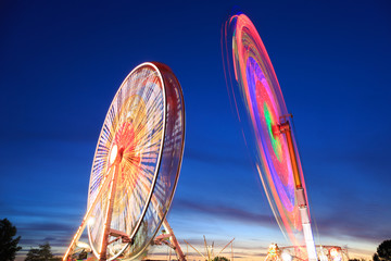 Amusement park at dusk - Ferris wheel in motion