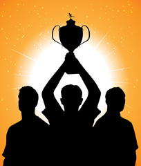 silhouettes of athletes with a cup