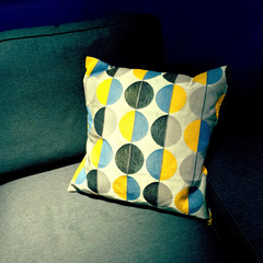 Colorful cushion decorating a sofa