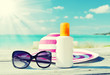 Sun lotion and sunglasses - 65861437