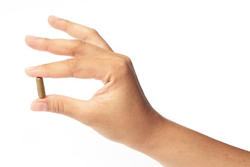 Hands with a pill herb