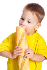 Little boy eating french baguette