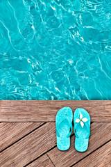 Blue flip flops on a wooden deck