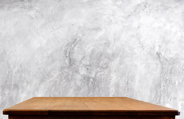 Concrete wall and wooden table