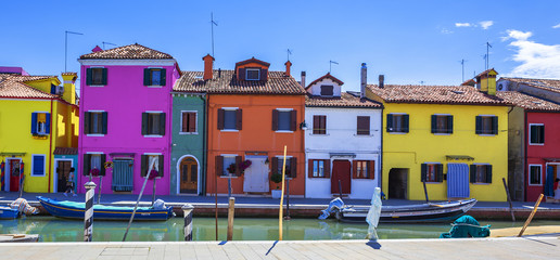 Colorful street with canal in Burano