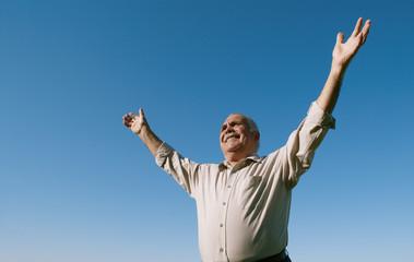 Senior retired man rejoicing in the sunshine