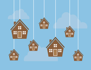 Many houses hanging from strings in the sky