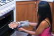 woman bakes pizza