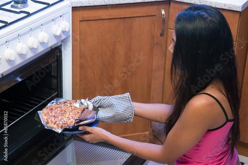 woman bakes pizza