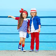 Fashion kids resting on the sea