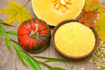 pumpkin and polenta in a bowl on a wooden background