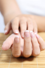 Close up of a beautiful woman hand french manicure