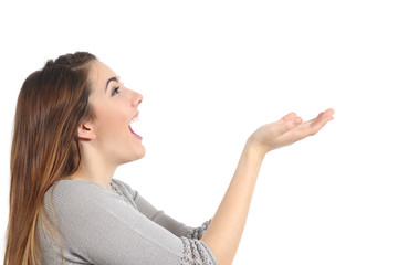 Profile of a woman holding something blank surprised