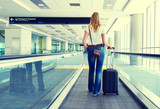 Girl with a suitcase on the speedwalk poster