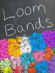 loom bands on a blackboard