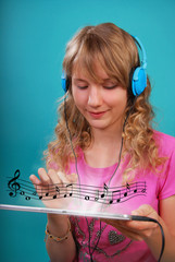 girl listening to the music on tablet