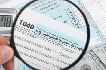 USA Tax Form 1040 with magnifying glass