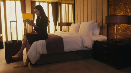 7of21 Business travel, people working in hotel room, woman
