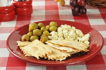 Flatbread crackers with feta cheese and olives