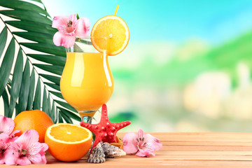 Refreshing orange cocktail on beach table
