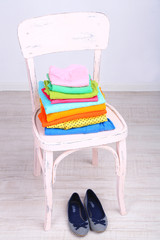 Clothes on chair on gray background