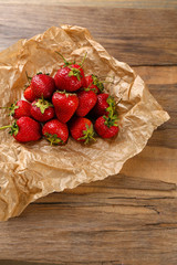 Red ripe strawberries with chocolate on wooden table
