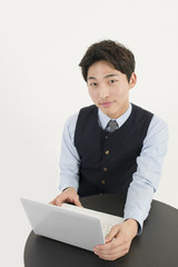 Asian businessman with laptop