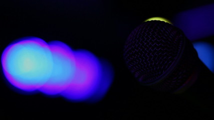 Microphone and concert lights turning on and off.