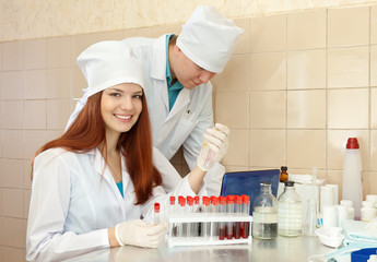 Two clinicians  in medical laboratory