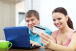 couple paying by credit card in internet