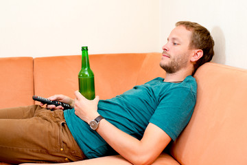 young man is relaxing at home