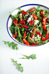 Rocket salad with strawberries, kalamata olives and goat cheese