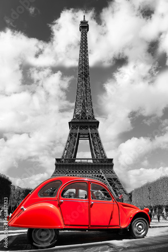 Eiffel Tower with red old car in Paris, France © samott