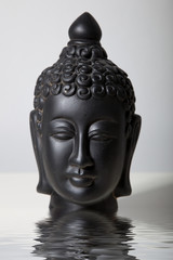 Black Buddha Head in Water