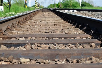 Detail of railway tracks with girder and gravel