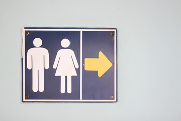Label the arrow pointing to the bathroom.