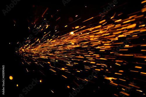 Foto op Canvas Vuur / Vlam Glowing Flow of Sparks in the Dark