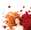 Beauty model girl with curly red hair and beautiful red roses
