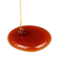 Dripping Honey on White Background