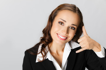 Businesswoman with call me gesture