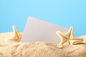 Starfish and blank card on beach