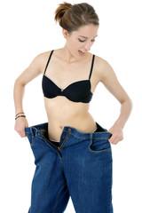 Frau ist schlank nach Diät und Abnehmen