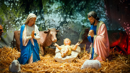 Christmas nativity scene with baby Jesus, Mary & Joseph in barn