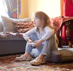 Boy Playing Console Game