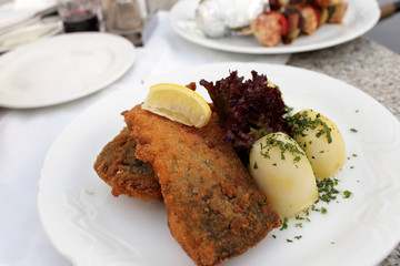 Fried carp with potatoes