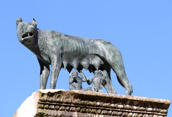 she-wolf nursing twins while founders of Rome with blue sky back